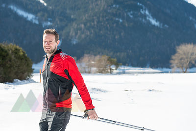 Austria, Tyrol, Achensee, portrait of smiling man doing cross country skiing