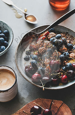 Healthy vegetarian breakfast with quinoa granola bowl and coffee