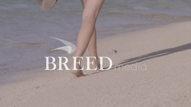 BMS001_003_HD_25fps_Bare_feet_walking_along_white_sandy_beach