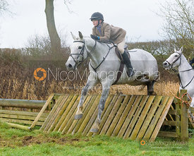 Lily Packe Drury Lowe jumping a hunt jump after the meet