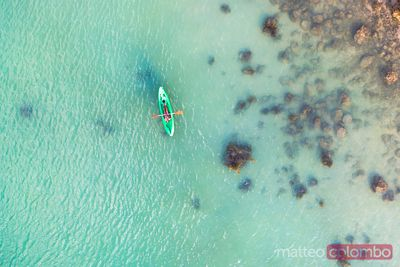 Aerial view of woman kayaking in the sea of Thailand