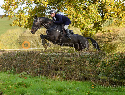 Meghan Healy jumping a fence at Wilson's - Cottesmore Hunt Opening Meet 2019