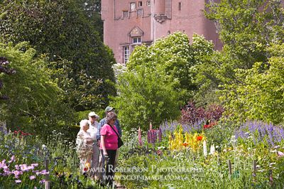 Image - Visitors and the June Border, Crathes Castle, Aberdeenshire, Scotland