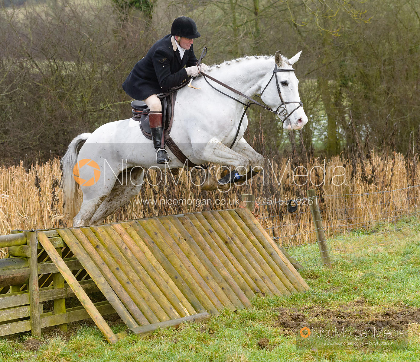 Willie Reardon jumping a hunt jump at Peakes - The Fitzwilliam Hunt visit the Cottesmore at Burrough House