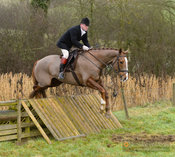 Ian Arthur jumping a hunt jump at Peakes - The Fitzwilliam Hunt visit the Cottesmore at Burrough House