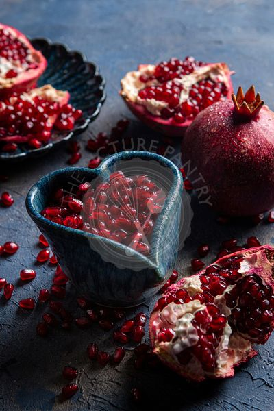 Pomegranates on blue background
