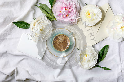 Coffee and peonies flowers