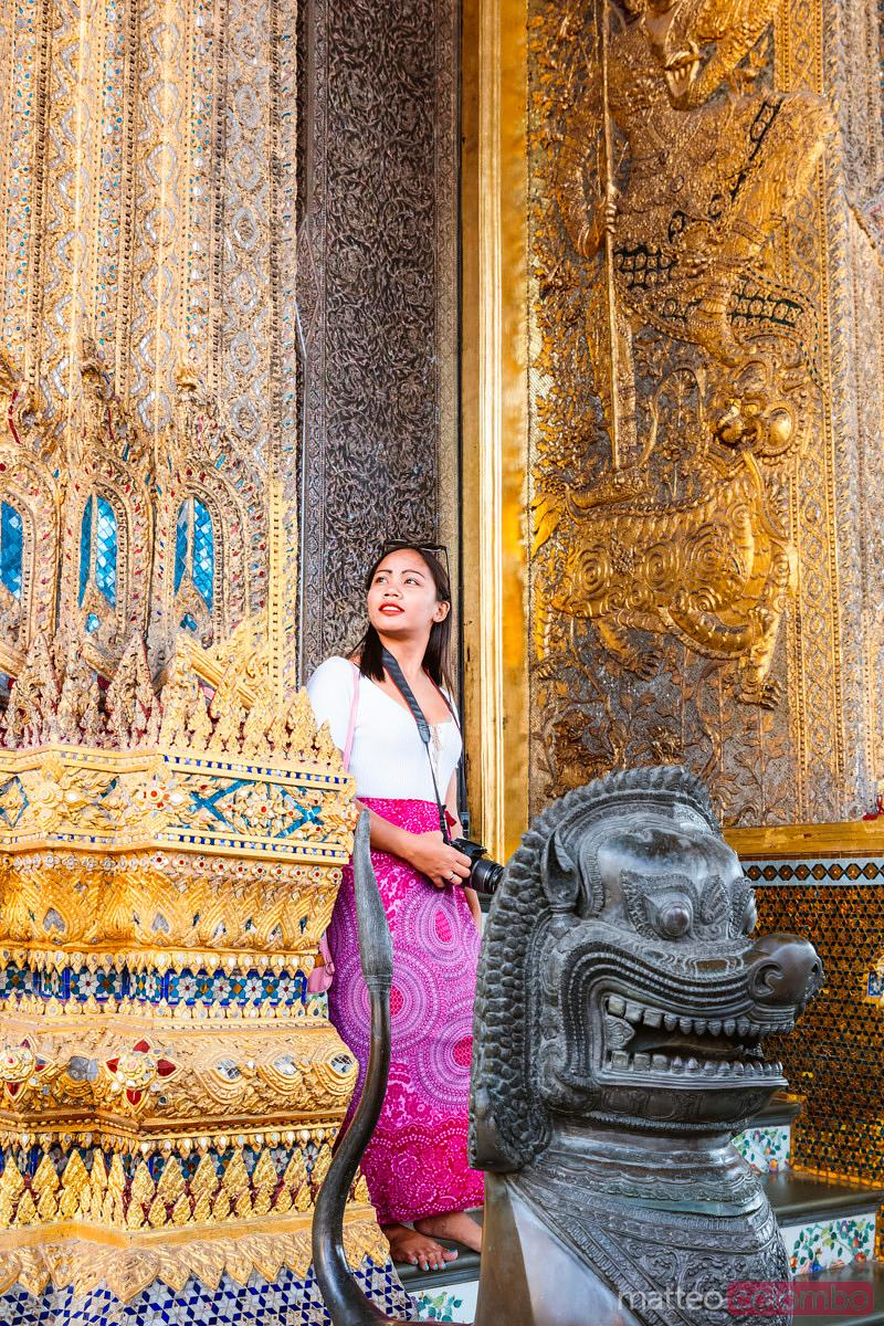 Asian woman visiting the Wat Phra Kaew, Bangkok, Thailand
