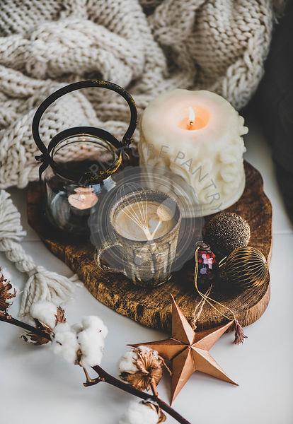 Christmas mood composition with coffee, candles and decorative toys