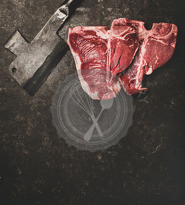Flat-lay of fresh uncooked beef meat t-bone steaks, copy space