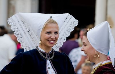 Croatian women in traditional local folk costume. Assumption Day, Pag, Croatia