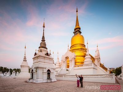 Tourist couple taking a selfie at Wat Suan Dok, Chiang Mai, Thailand