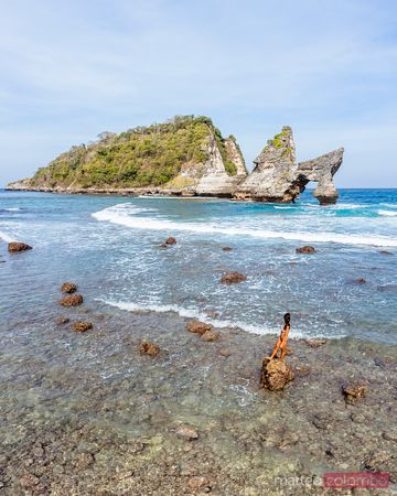 Woman in bikini in the sea, Nusa Penida, Bali, Indonesia