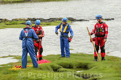 Four Coastguard officers during a search in the Sound of Mull