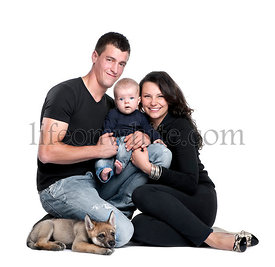 Portrait of young family with baby boy and 2 months old wolf