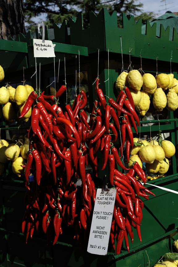 Chili peppers and citrons at a fruit kiosk in front of the Scaliger Castle. It is the only such kiosk left in Northern Italy.