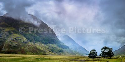 Highland landscape with mist and cloud hanging over two munros near Glencoe