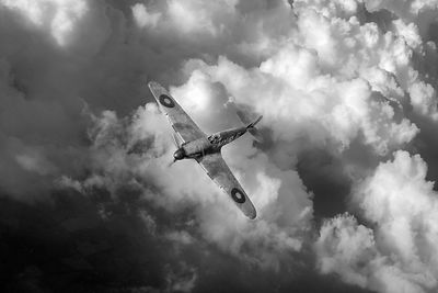 RAF Hurricane above clouds