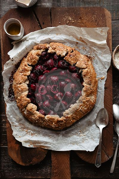 Cherry galette on a wooden table