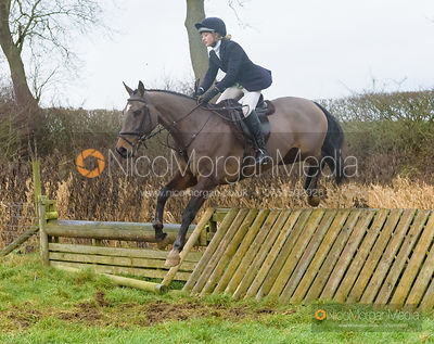 Amelia Leeming jumping a hunt jump after the meet