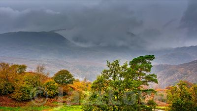 Dramatic sky over Lake District hills in autumn.
