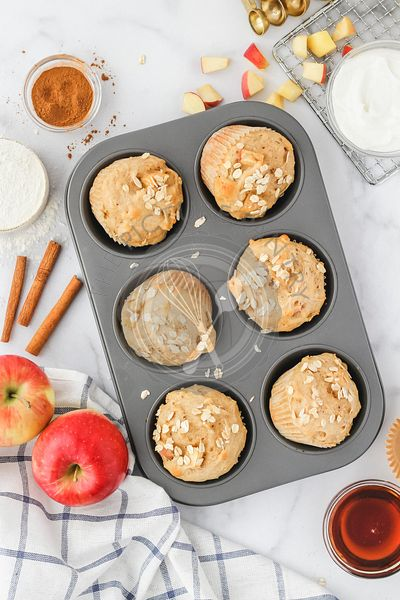 Baked Apple Cinnamon Muffins in muffin tin with ingredients