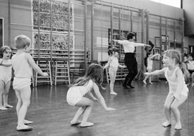 #77324,  Music and movement, exercises in the gym, Vittoria Primary School, Islington, London.  1970.