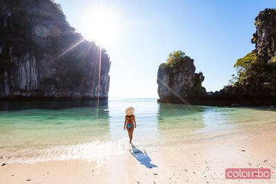 Woman walking into the lagoon, Hong island,  Thailand