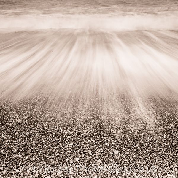 Receding waves on a pebble beach