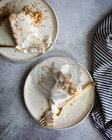Vanilla streusel  ice cream cake on a plate.
