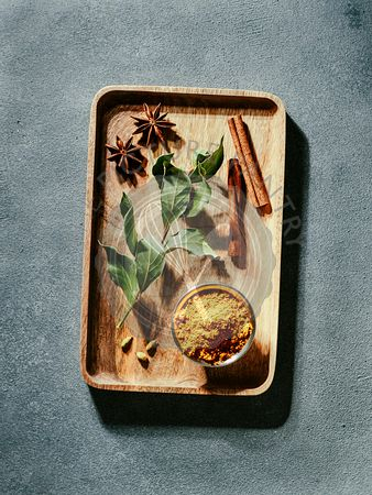 Garam masala and ingredients, vertical, top view