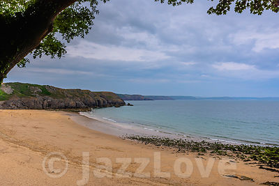 Moody sky over Barafundle bay. Sandy beach on scenic coast of Pembrokeshire,  South Wales, UK.