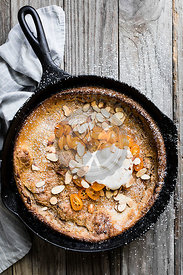 Cinnamon spiced almond dutch baby with honeyed kumquats, and a dollop of vanilla bean crème fraîche.