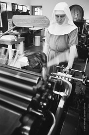 #120083, One of the Sisters operating the print machine in the printworks at Ladywell Convent, Godalming, the Motherhouse of ...