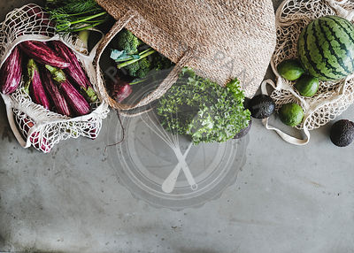 Eco-friendly jute bags full of fresh vegetables, copy space