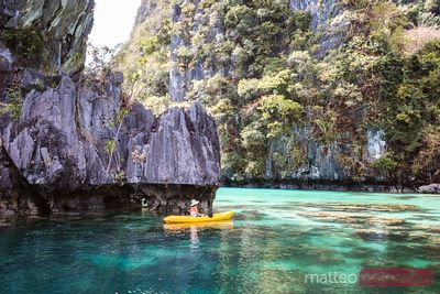 Woman in a canoe at Big Lagoon, El Nido