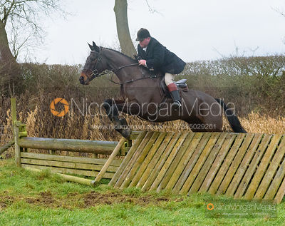 George Kennedy jumping a hunt jump after the meet