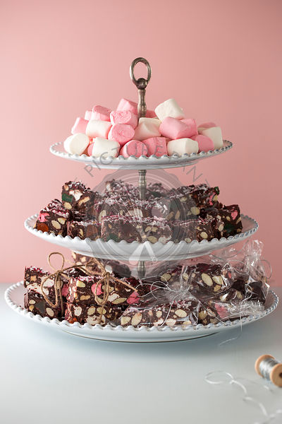Chocolate brownies with marshmallows, hand wrapped in string.