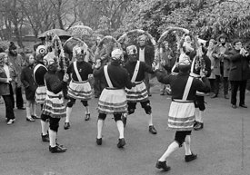 #77108,  The 'Nutters' Dance', Bacup, Lancashire,  1973.  On Easter Saturday every year the 'Coconut Dancers' gather at one b...