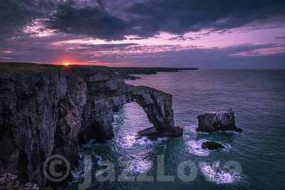 Sunrise over Green Bridge of Wales, Pembrokeshire,South Wales, UK.