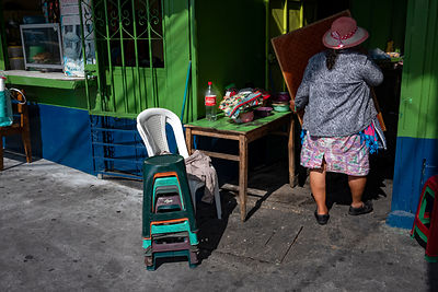 A woman opens her shop in Guatemala City