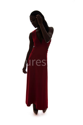 A silhouette, of a woman in a red dress – shot from eyelevel.