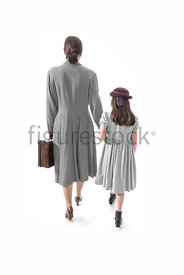 A 1940's woman and little girl, walking away – shot from eye level.