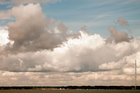 #061928,  Gathering cumulus storm clouds at sea.