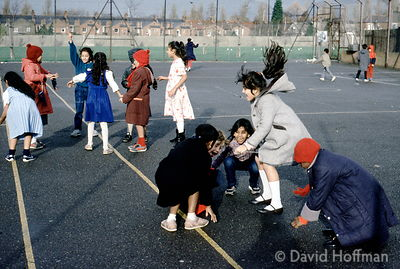 5.5/93 Children playing in school playground, Tower Hamlets, London.
