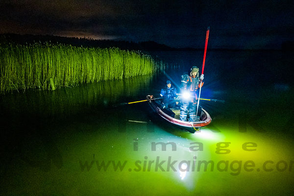 Night fishing with torch