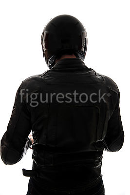 A silhouette of a mystery man in biker Leathers and a helmet – shot from eye level.