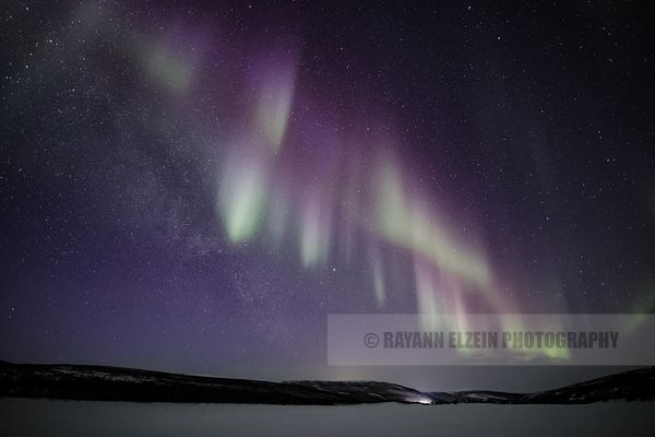 Aurora above the Teno River in Lapland