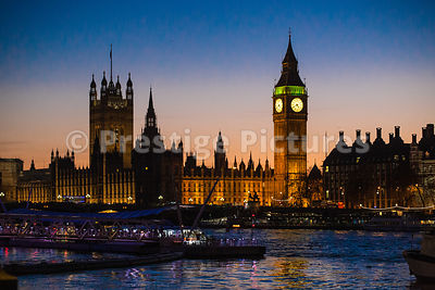 The Houses of Parliament from Across the River Thames with an Orange Sunset and Beautiful Reflections in the Water