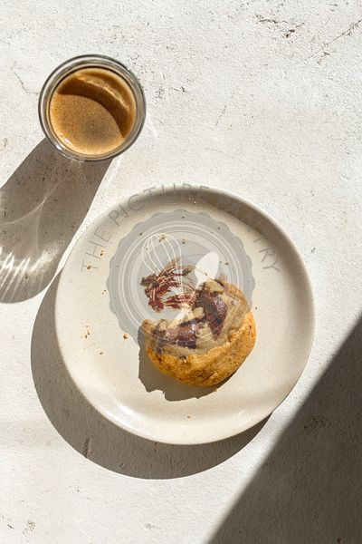 Chocolate cookie and coffee on white background